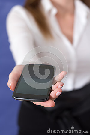 Woman showing a mobile phone