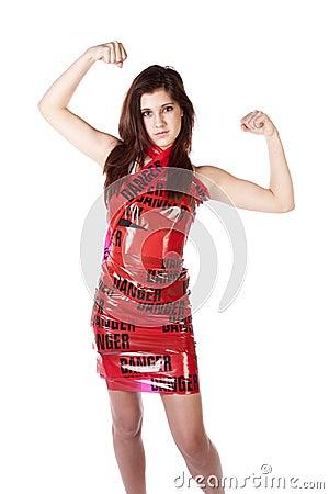 Woman showing muscles danger