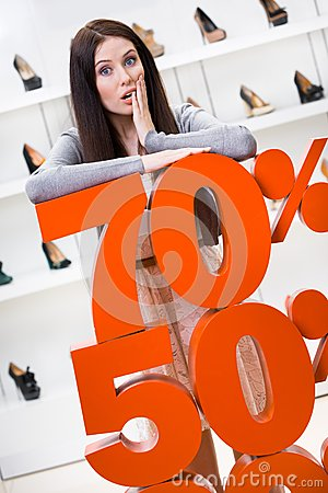 Woman showing the percentage of sales on footwear