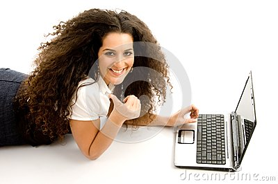 Woman showing thumbs up and working on laptop