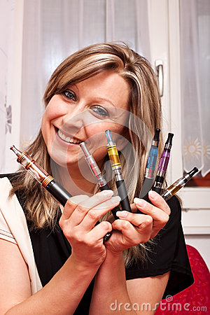 Woman shows her collection electric cigarettes