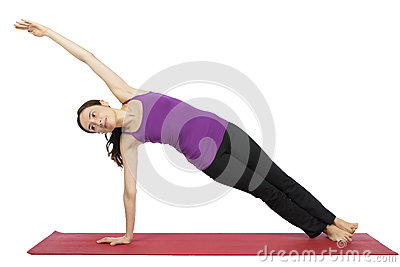 Woman in Side Plank Pose in yoga Stock Photo