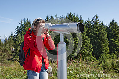 Woman with sightseeing binoculars