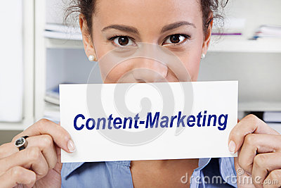 Woman with sign of content marketing in her hands