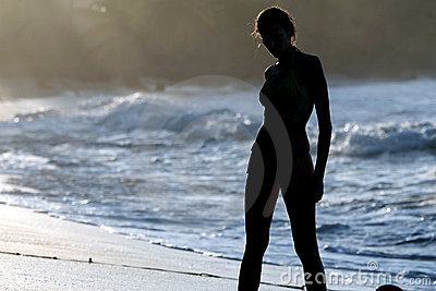 Woman silhouette at the beach