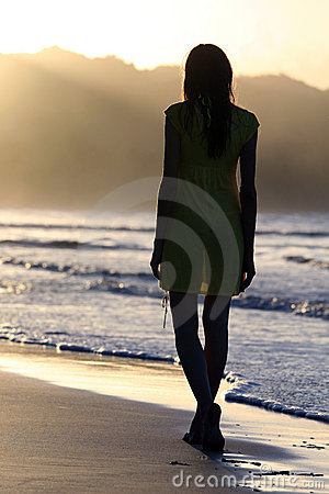 Woman silhouette on the beach