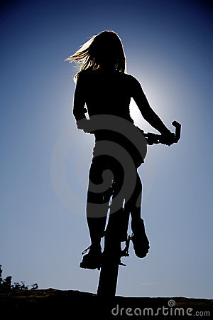 Woman silhouette on bike