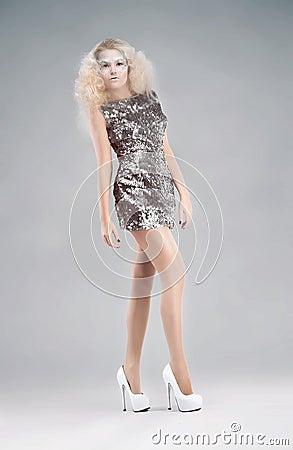 Woman in silver dress