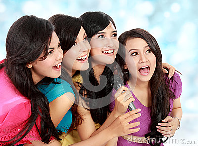 Woman singing karaoke together