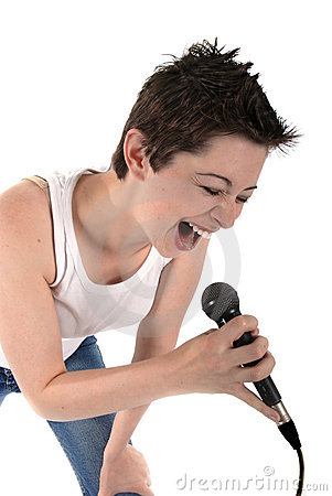 Woman singing into a microphon