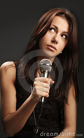 Woman singing into microphone
