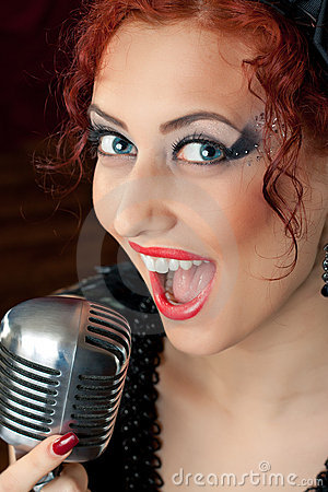 Woman singing into vintage microphone