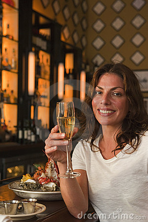 Woman sipping French champagne