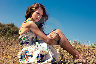 woman sit in field