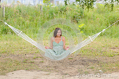 Woman sit on hammock in the park