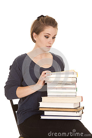 Woman sit with lots of books shock
