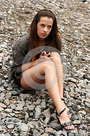 Free Woman Sit On The Ground Royalty Free Stock Image - 27617916