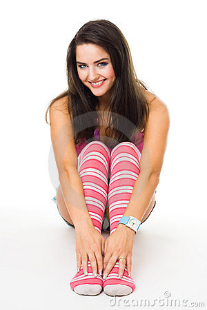 Woman sit in pink striped socks smiling look at ca