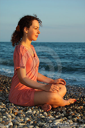 Free Woman Sits And Meditation Ashore Of Sea Stock Image - 10699161