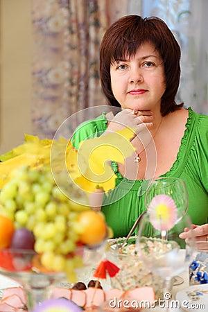 Woman sits at banquet table