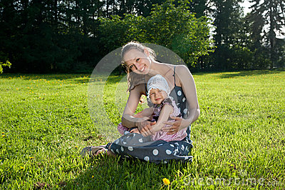 Woman sits with a daughter