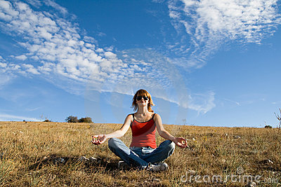Woman sits on the ground and meditate