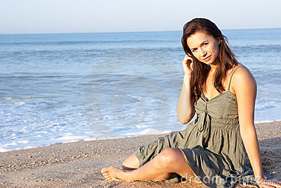 Woman sitting on beach relaxing