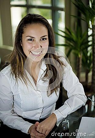 Woman sitting behind a desk