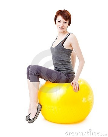 Woman sitting on a big fitness ball