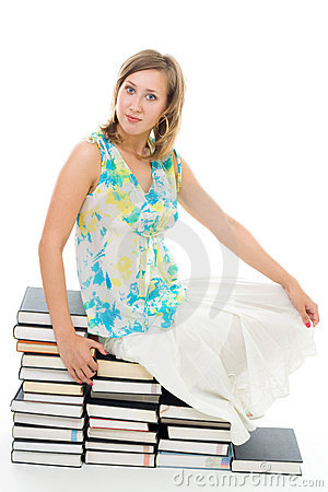 Woman sitting on books