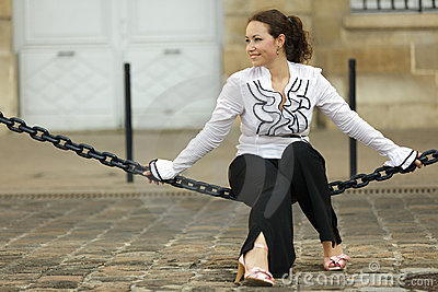 Woman sitting on chain
