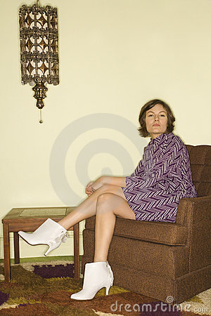 Woman sitting in chair.