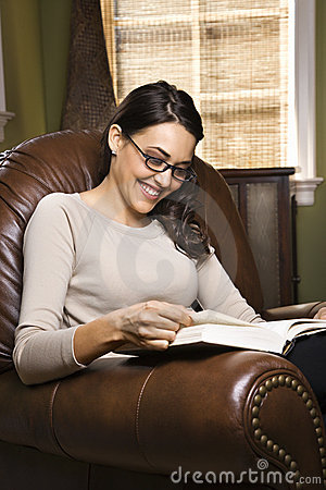 Woman sitting in chair reading
