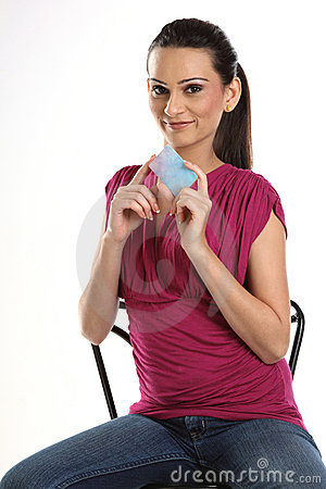 Woman sitting with credit card