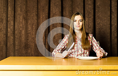 Woman Sitting at Empty Table