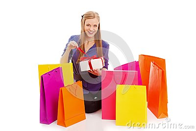 Woman sitting on the floor behind shopping bags