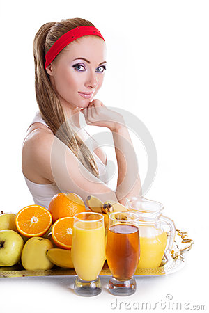 Woman sitting with fresh juices and fruits
