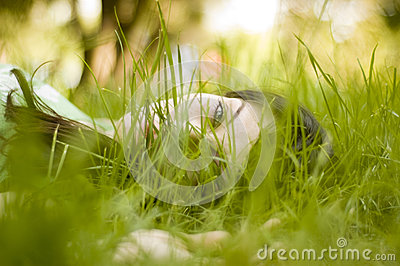 Woman sitting in grass