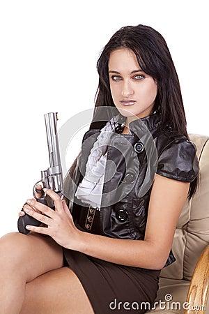 Woman sitting gun up