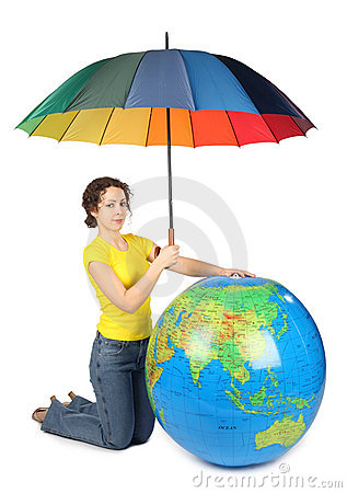 Woman sitting and holding umbrella under big globe
