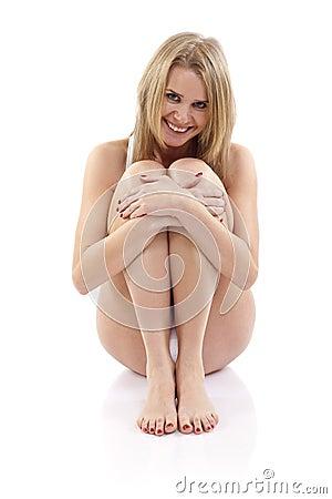 Woman sitting hugging legs