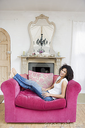 Free Woman Sitting In Living Room Smiling Stock Photo - 5688120