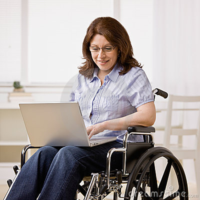 Free Woman Sitting In Wheel Chair Typing On Laptop Royalty Free Stock Photo - 6599775