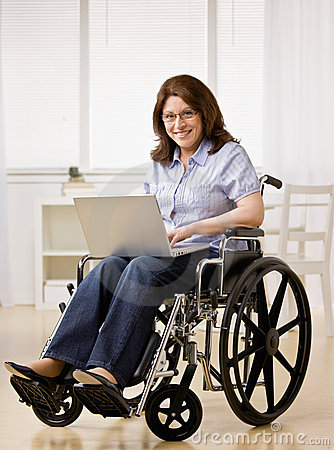 Free Woman Sitting In Wheel Chair Typing On Laptop Royalty Free Stock Images - 6599779