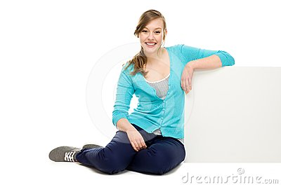 Woman sitting next to blank board