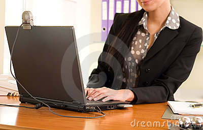 Woman sitting in the office in front of the laptop