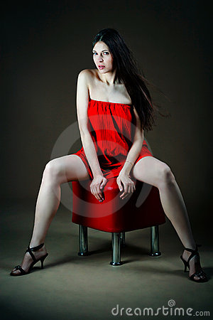 Free Woman Sitting On Banquette Royalty Free Stock Photography - 18302407