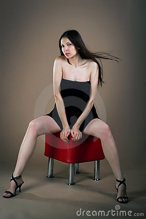 Free Woman Sitting On Banquette Royalty Free Stock Photography - 22962497