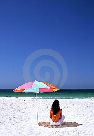 Free Woman Sitting On Spanish Beach Under Sun Umbrella. White Sand Blue Sea And Sky. Royalty Free Stock Photos - 125528