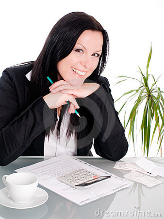 Woman sitting with papers and calculator